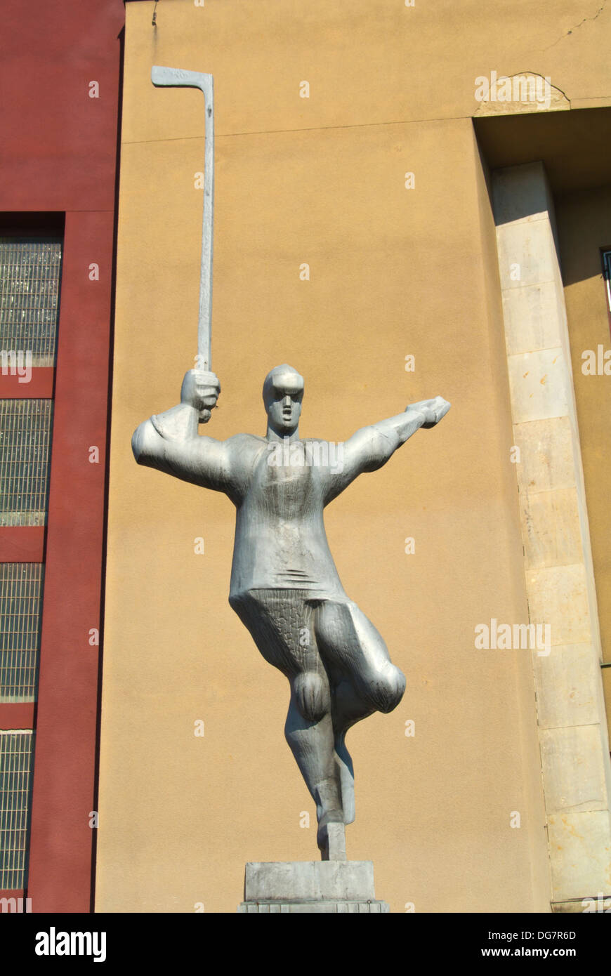 Hokejista the hockey player sculpture (1985) by Zdenek Nemecek in front of ice hockey arena at Vystaviste Holesovice, Prague - Stock Image