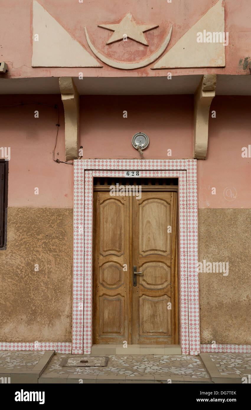Senegal, Saint Louis. Doorway to Private Residence with Islamic Star and Crescent Above. - Stock Image