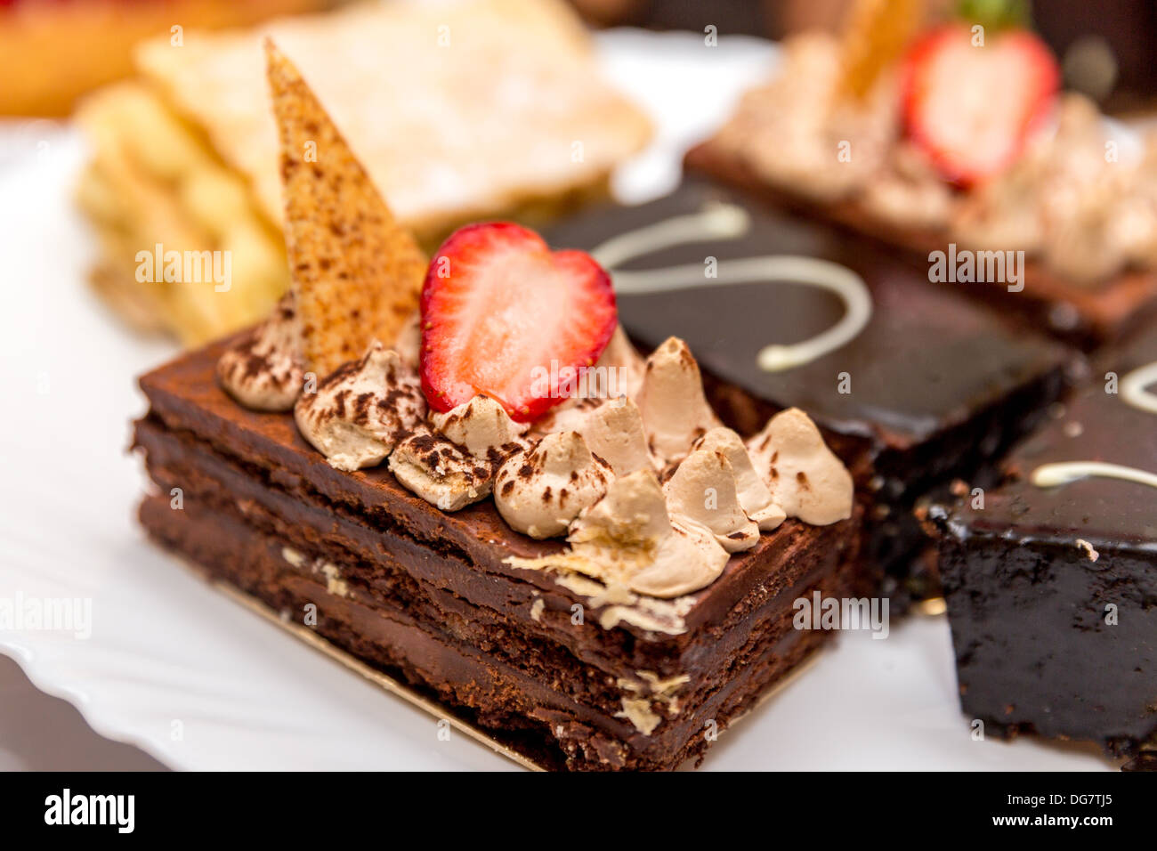 Beautifully decorated chocolate brownie with strawberry topping - Stock Image