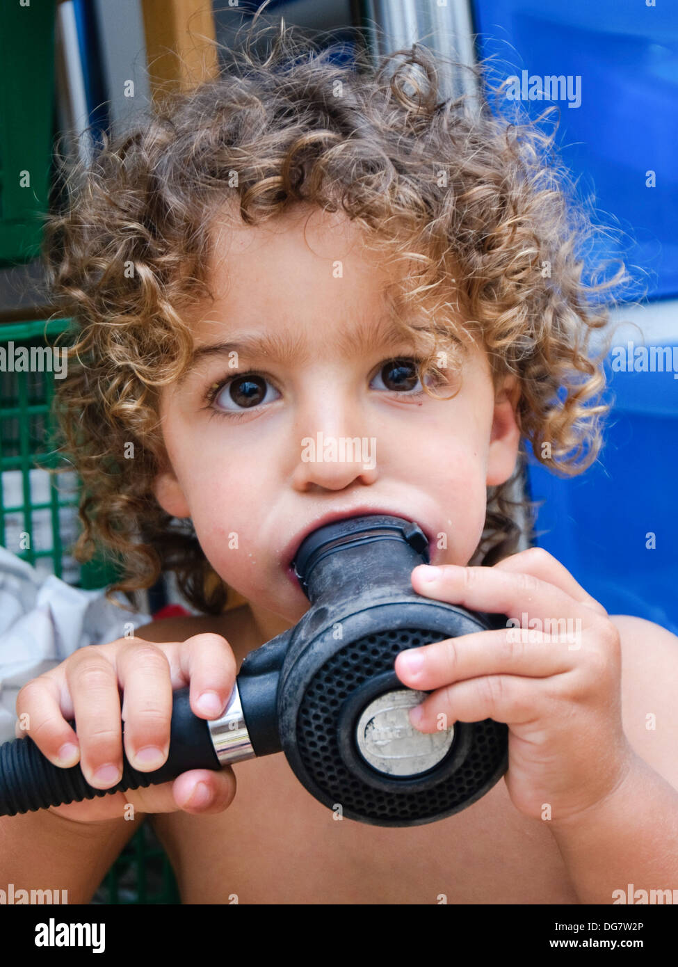 Young boy with a scuba diving mouthpiece in his mouth Model release available - Stock Image