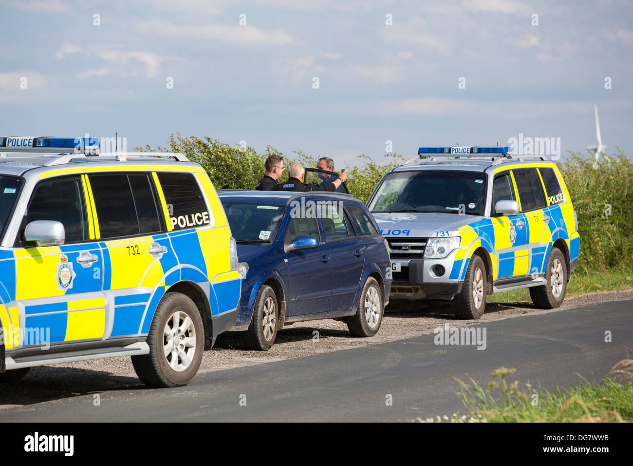Climate change photographer, Ashley Cooper, being stopped by police - Stock Image