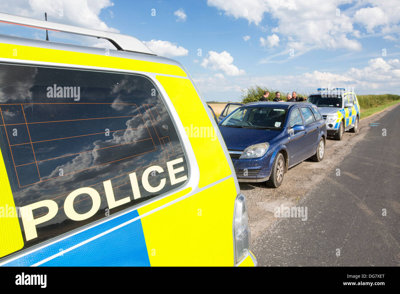 Climate change photographer, Ashley Cooper, being stopped by police. - Stock Image