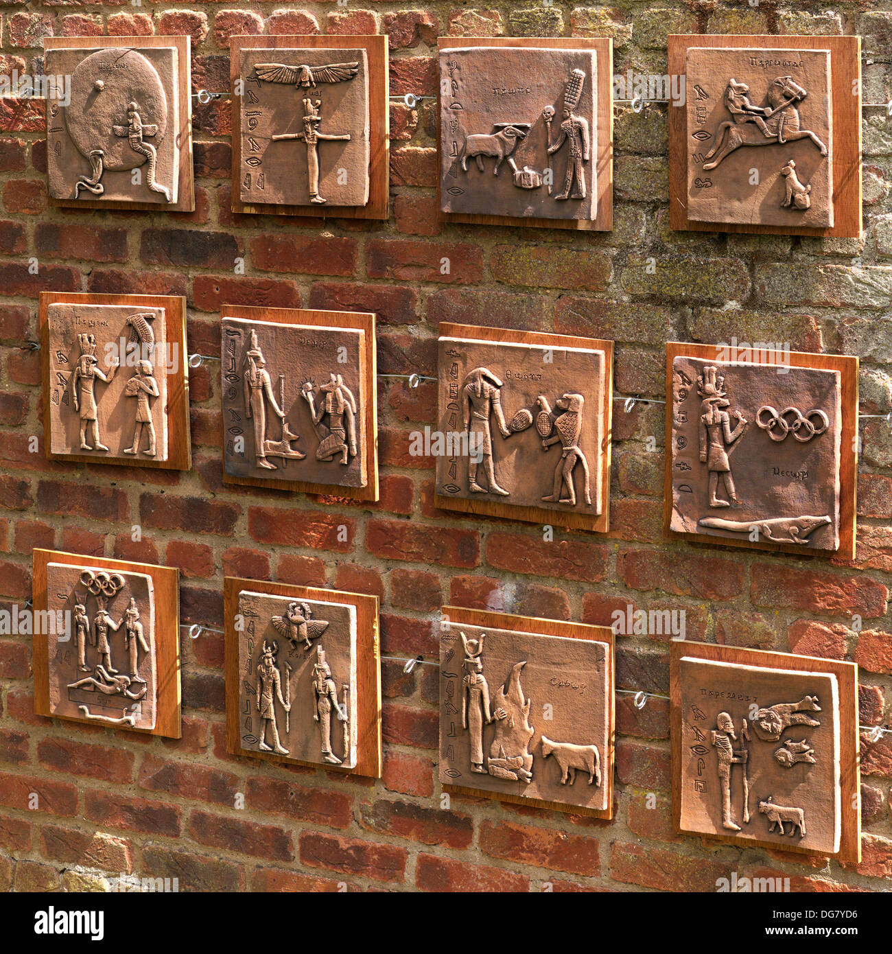 Egyptian hieroglyph inspired artwork ceramic tiles on red brick wall ...