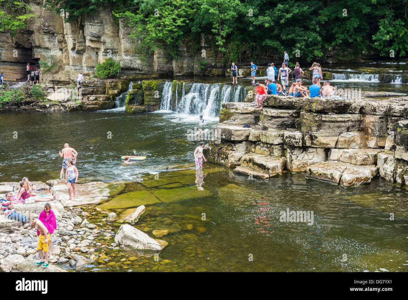 Summer swimming in the River Swale at Richmond, North Yorkshire Stock Photo