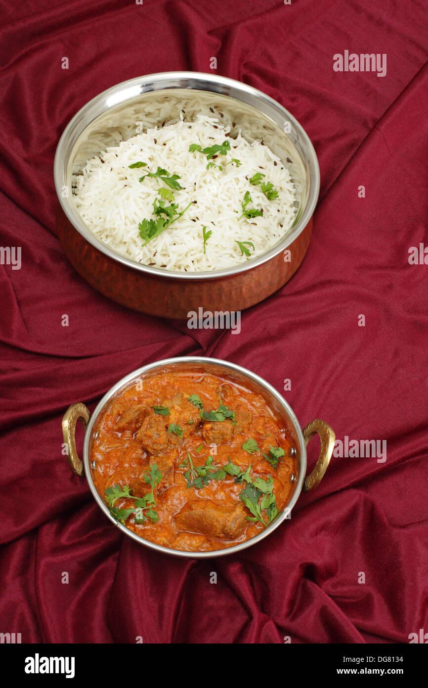 Lamb rogan josh, served with jeera (cumin) rice - Stock Image