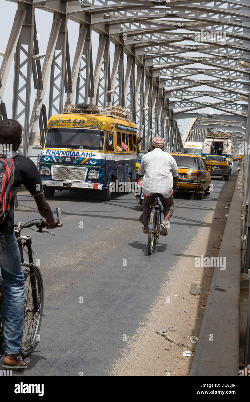 Senegal, Saint Louis. Vehicular Traffic on the Pont Faidherbe, Bridge over the River Senegal. Built 1897. - Stock Image