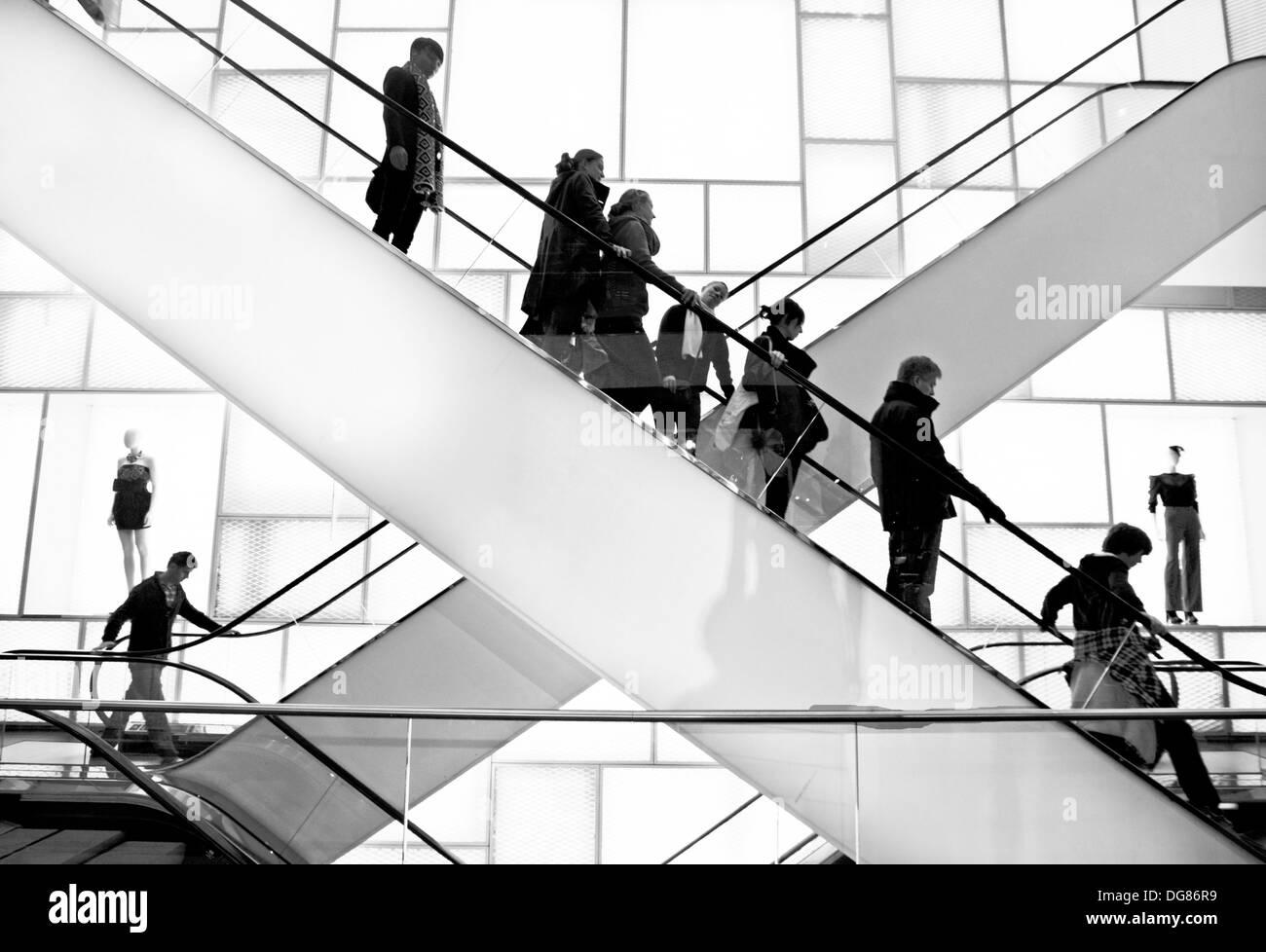 shopping center escalators stark black and white,Crowd And Escalator - Stock Image