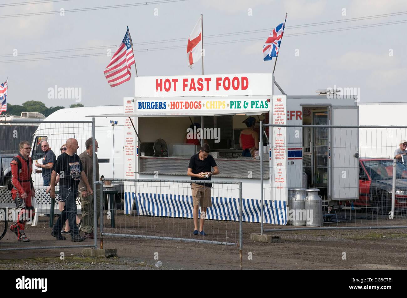 burger van vans fast food trailer food wagon hot catering outdoor burgers event events - Stock Image