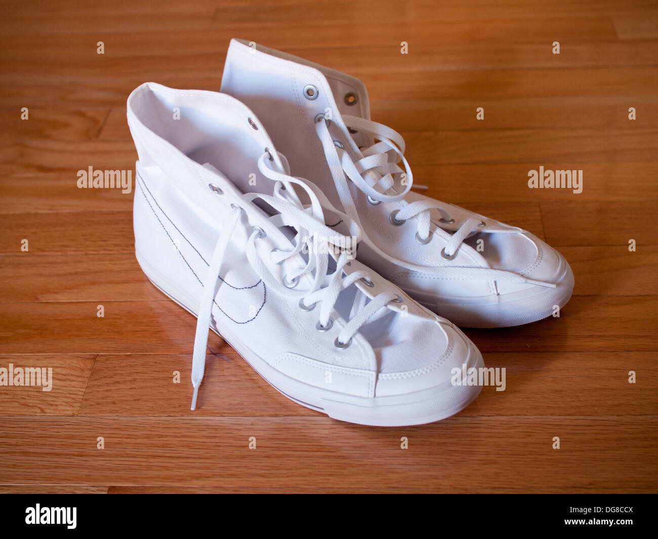 A pair of white Nike Go Mid Canvas casual canvas sneakers, 2011 model. - Stock Image