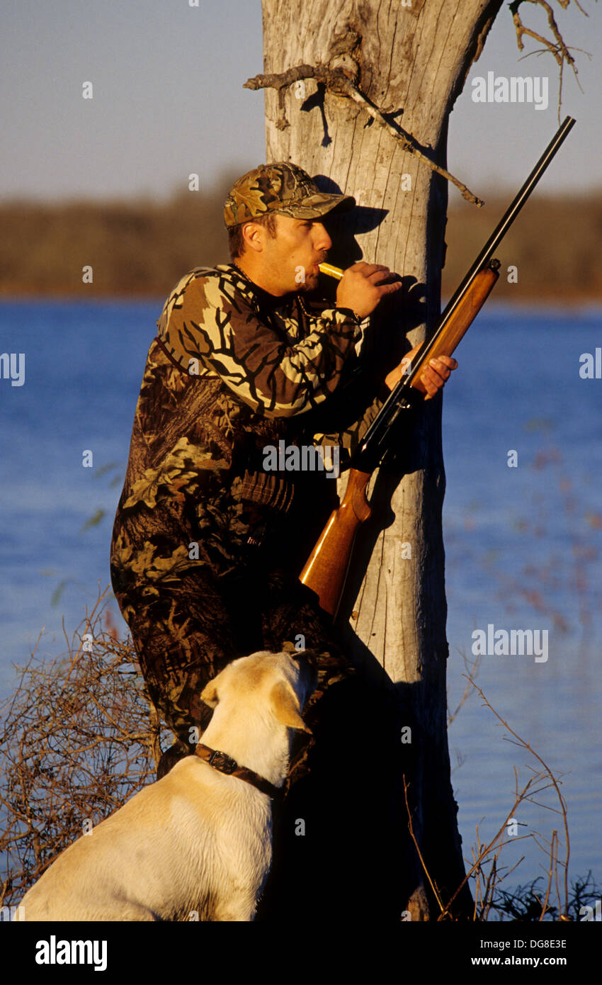 FROST B HUNTER SPORTMAN WITH HIS DOUBLE-BARRELED SHOTGUN HUNTING QUAIL HUNT A