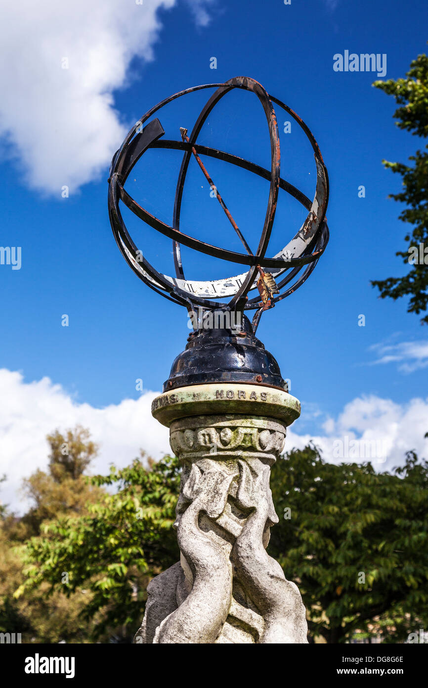 The sundial, a form of orrery, set on a marble dolphin pedestal in the Parade Gardens, Bath, UK. - Stock Image