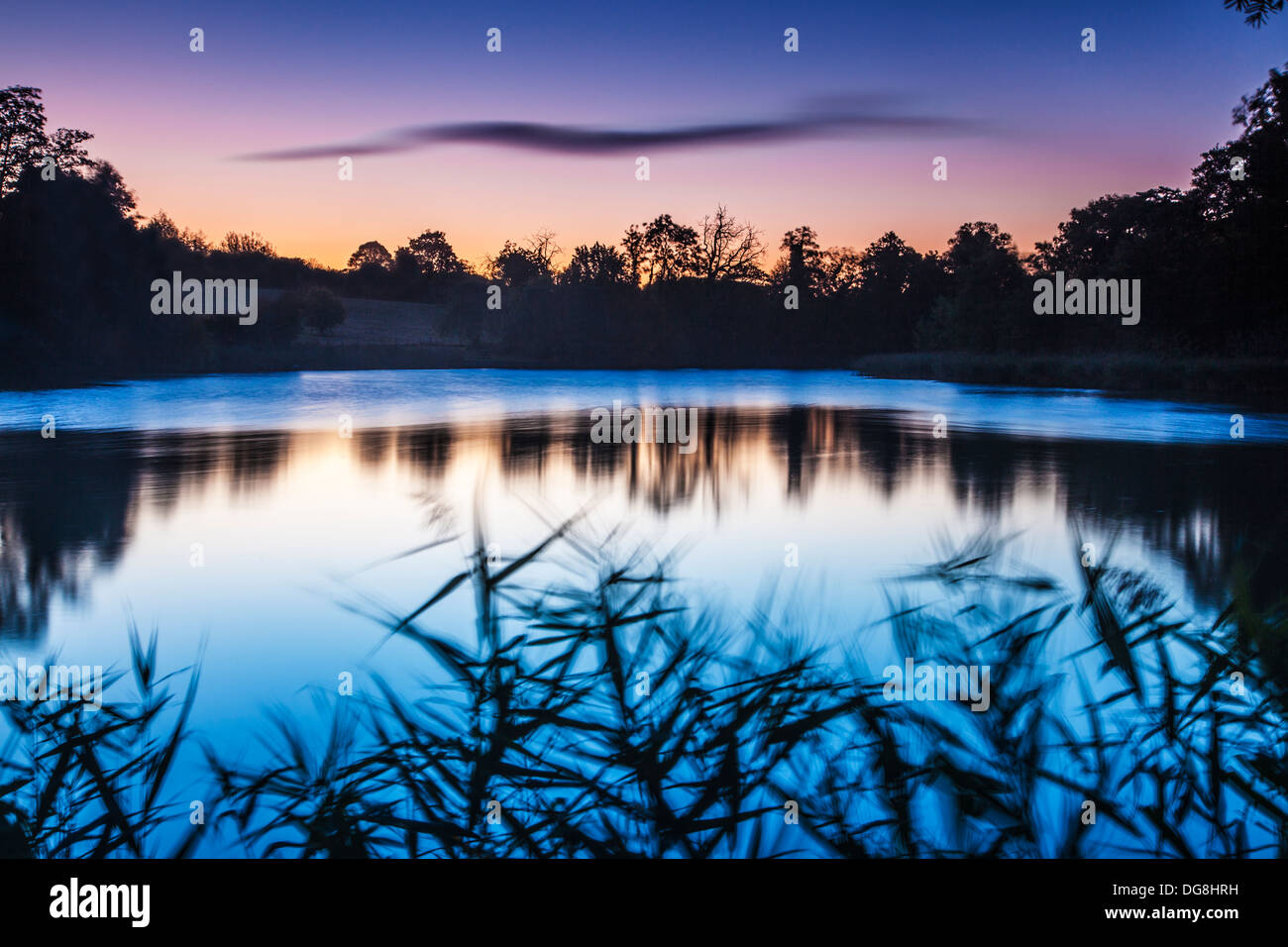Twilight over the lake at Stanton Park in Swindon, Wiltshire, UK. - Stock Image