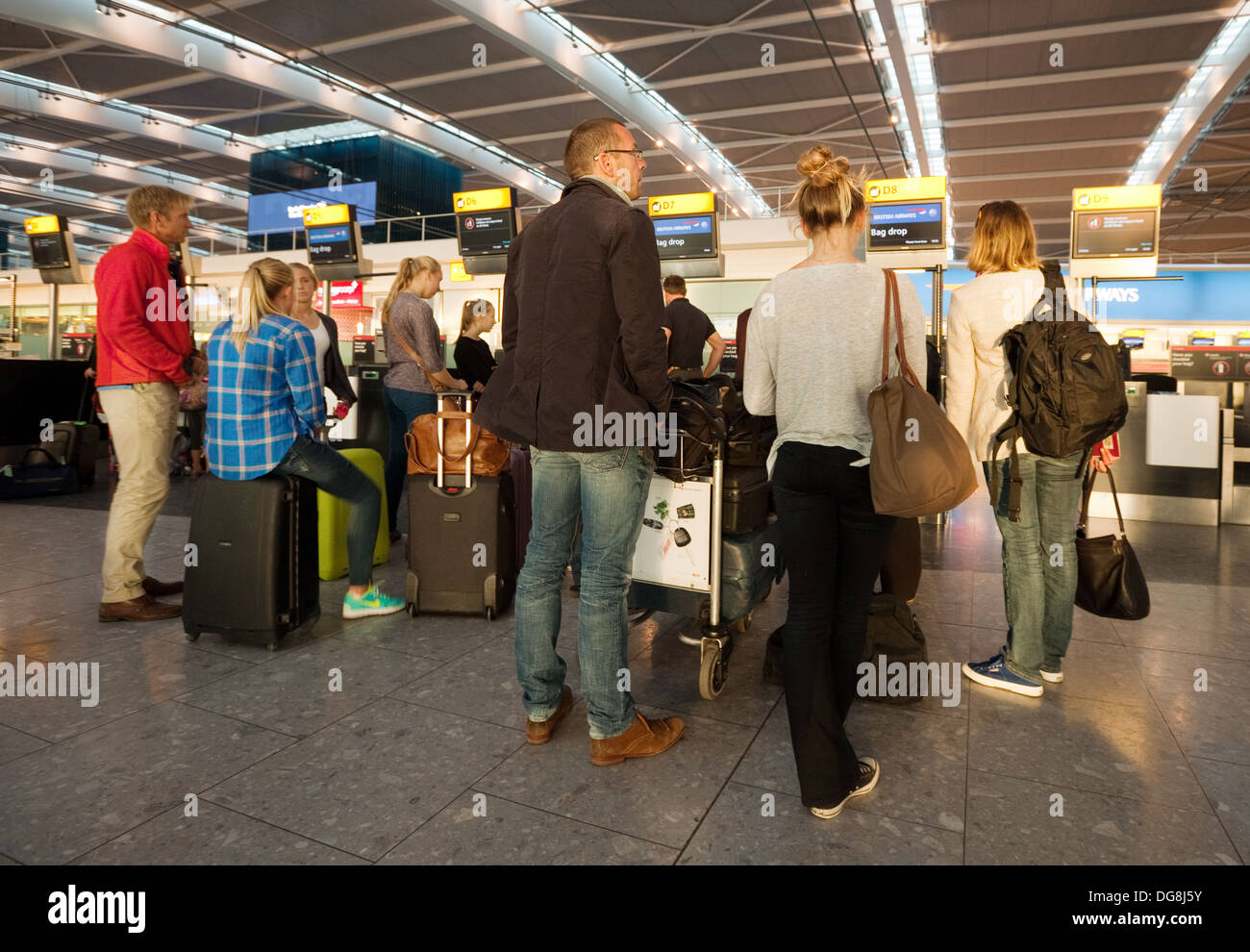 People in a queue at the Check in, Terminal 5, Heathrow airport London UK - Stock Image