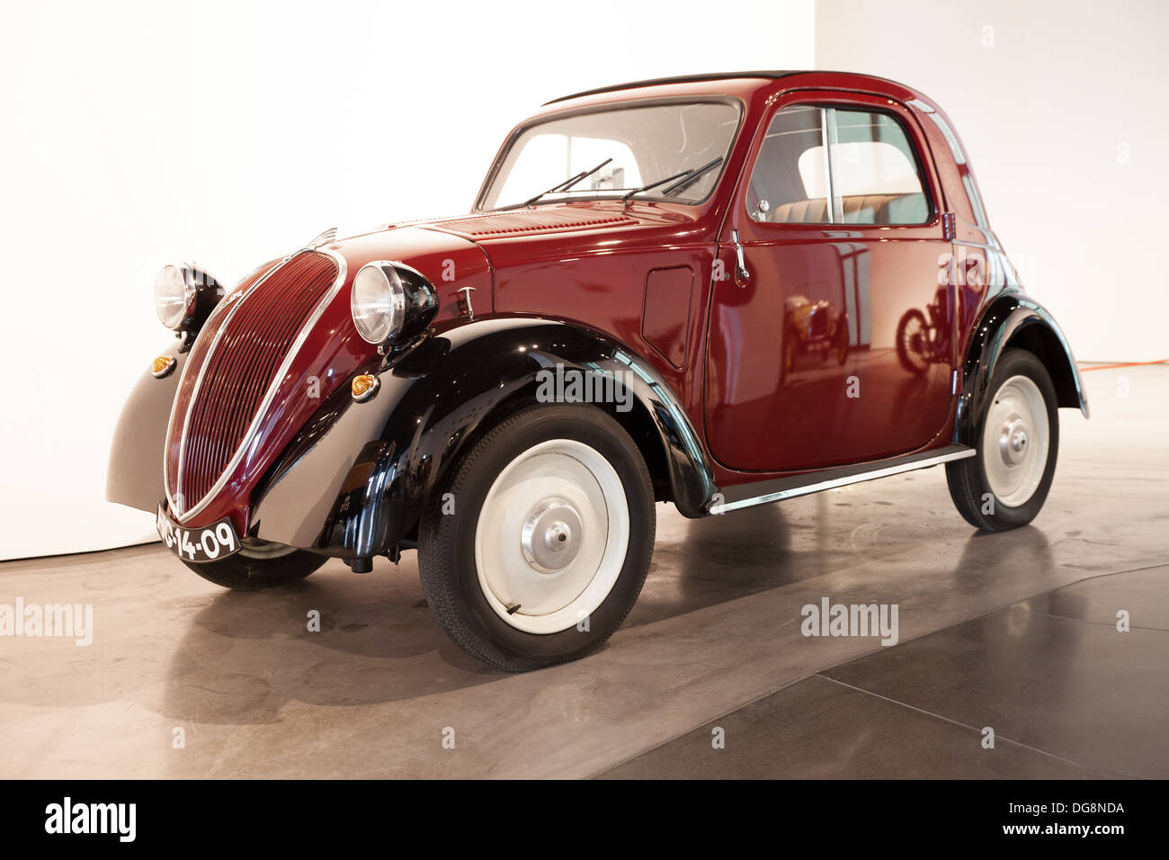 Fiat 500 Topolino (model 1936), Malaga car Museum, Spain. Malaga car museum holds one of the largest collection of vintage cars. - Stock Image