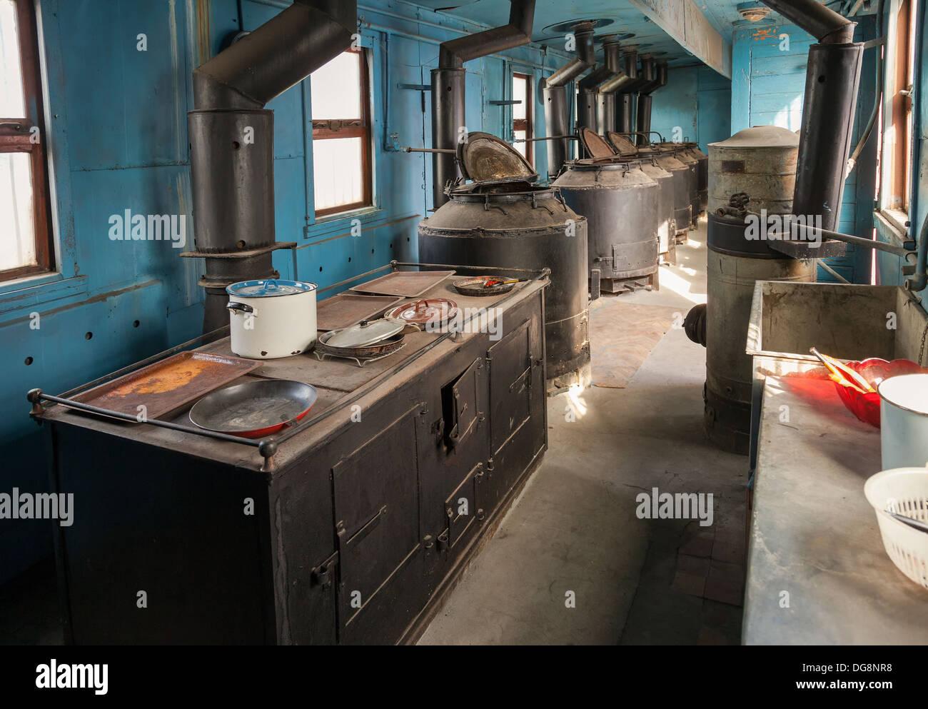Interior of old railway wagon kitchen - Stock Image