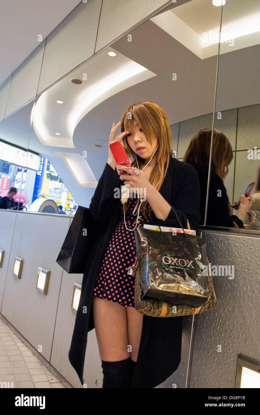 young fashion victim at department store 109 in Shibuya,Tokyo,Japan - Stock Image