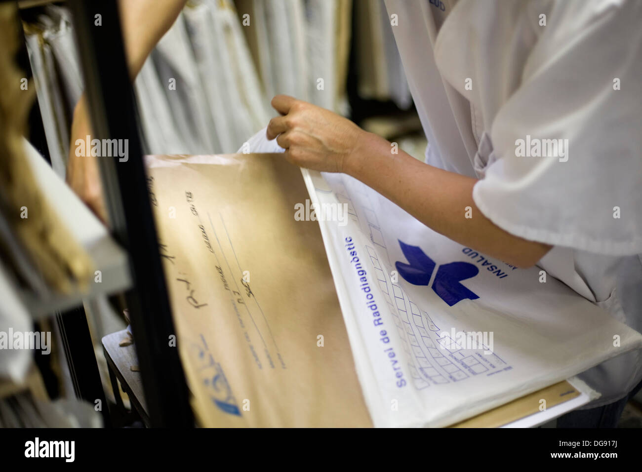Nurse with radiography files - Stock Image