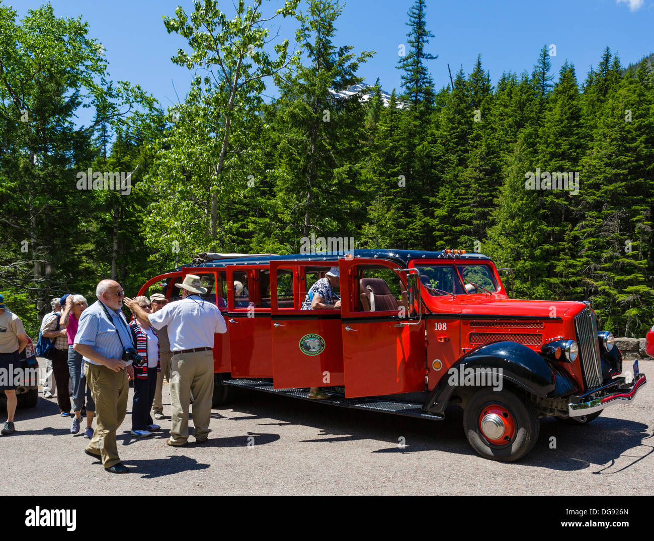 Tourists on the Red Bus Tour at McDonald Falls, Glacier National Park, Montana, USA - Stock Image