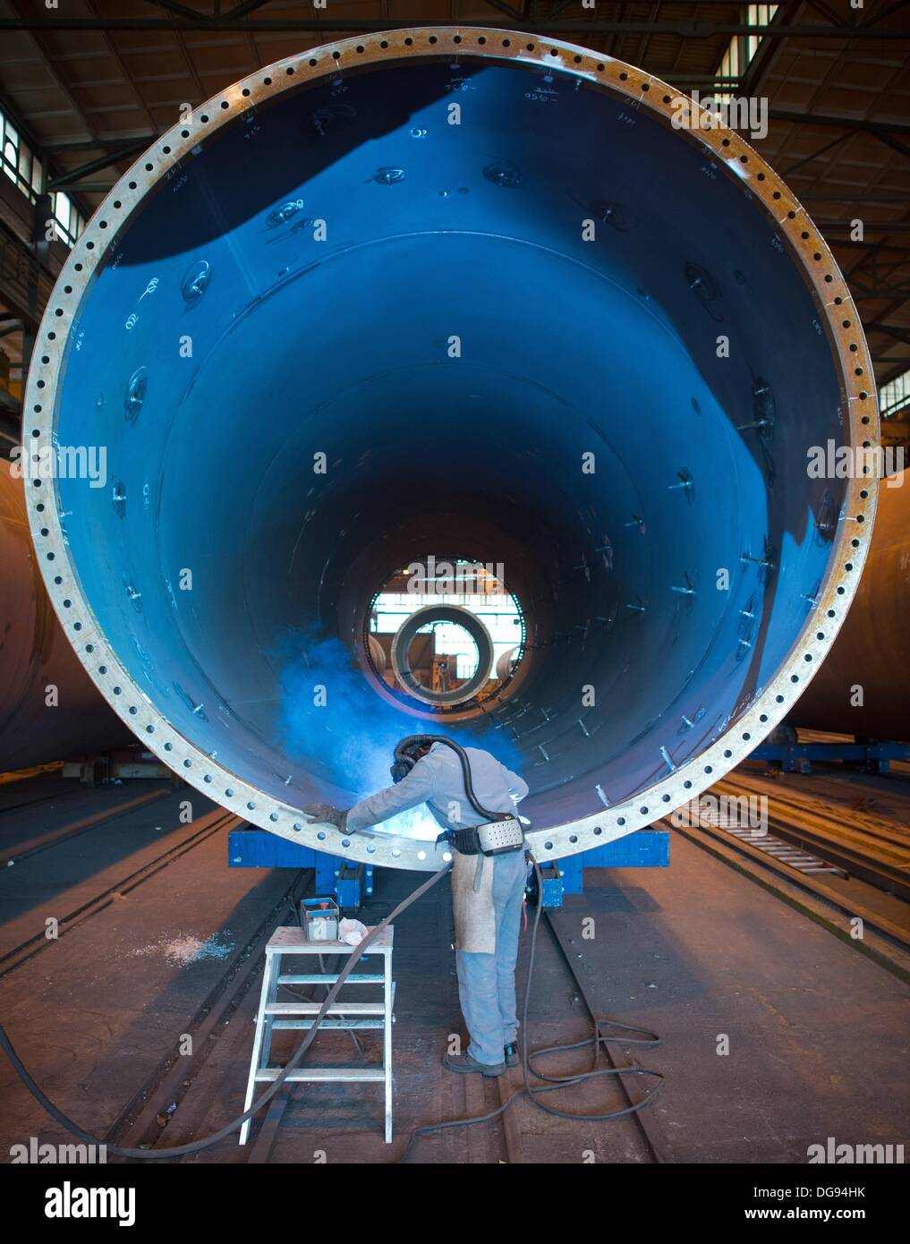 Fuerstenwalde, Germany. 15th Oct, 2013. A welder of the chemical and tank facility construction company Reuther Stock Photo