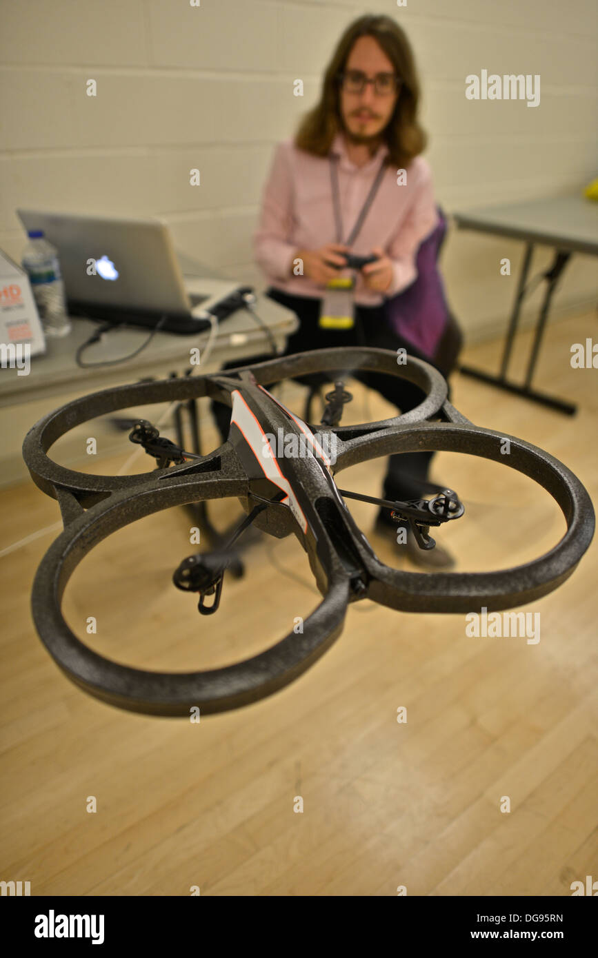 Julian Cheal (Nodecopters) hacking an AR Drone quadcopter at the Drones and Aerial Robotics Conference (DARC), held at New York - Stock Image