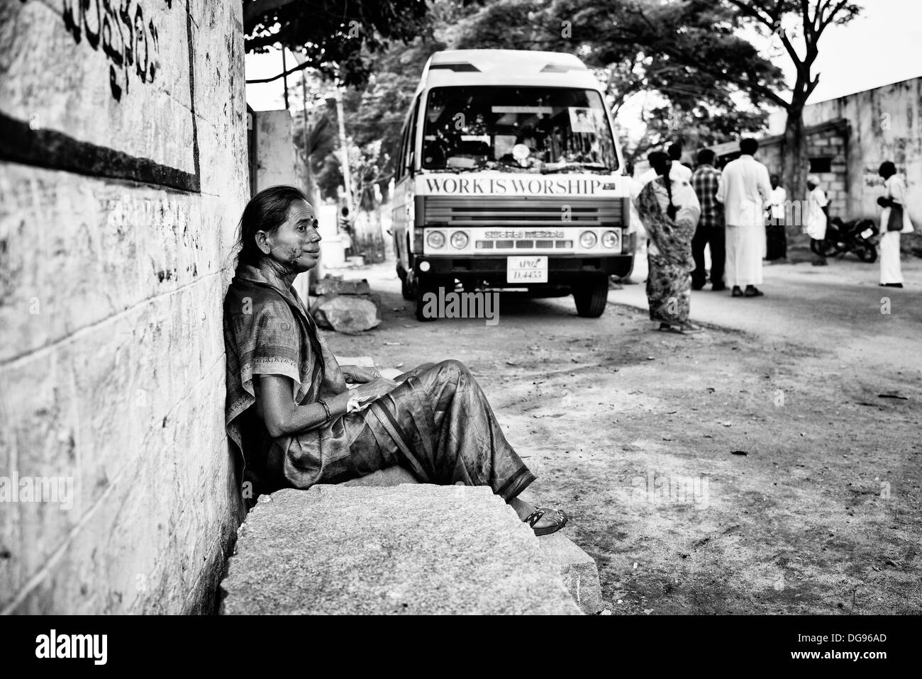 Indian woman patient with facial skin graft scars waiting at Sathya Sai Baba mobile outreach hospital. Andhra Pradesh, Stock Photo