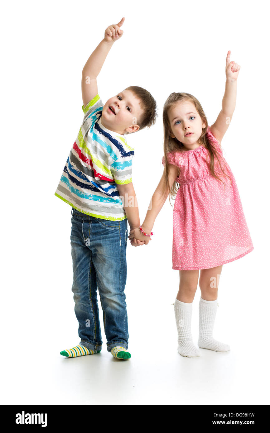 kids boy and girl showing something up - Stock Image