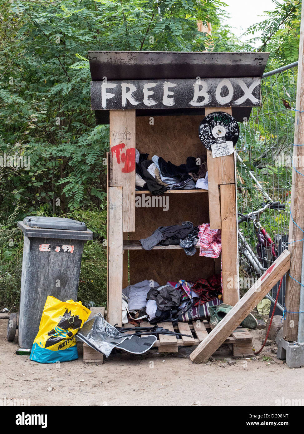 Free box for donations.Squatters set up informal tented community using recycled materials to build homes and gardens  - Berlin - Stock Image