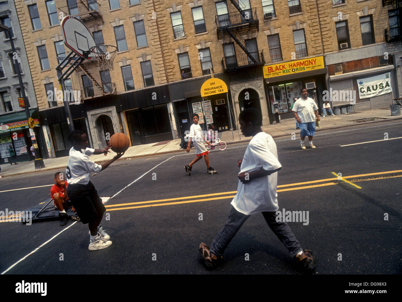 New York, NY - August 1994 - Children play ball during a street fair in West Harlem. Rally to Stop the Violence. Stock Photo
