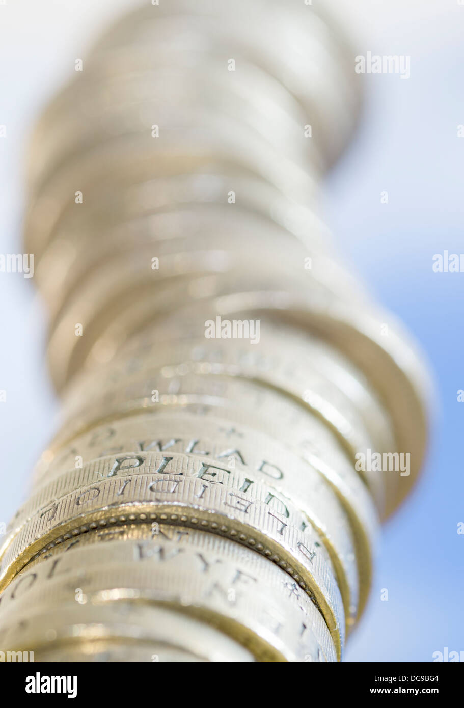 A pile of pound coins disappearing into the sky - Stock Image