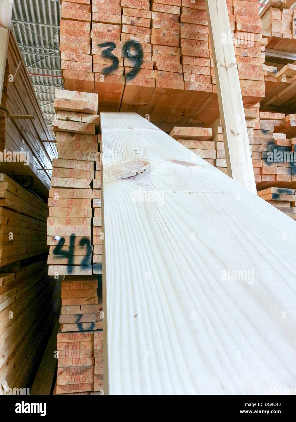Pine wood planks in a Lumber yard - Stock Image