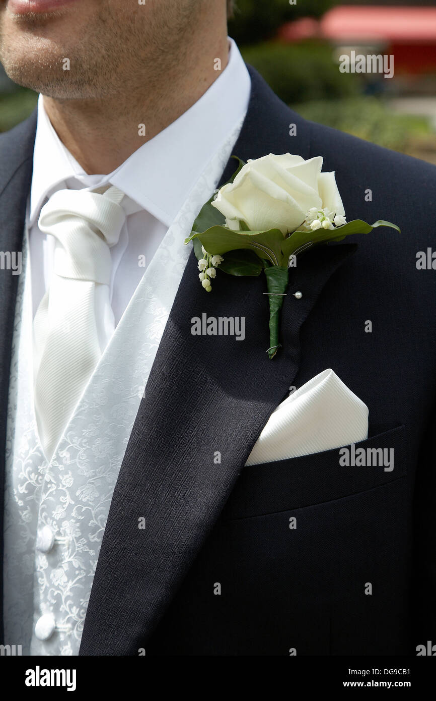 Groom with flower in buttonhole on suit. Stock Photo