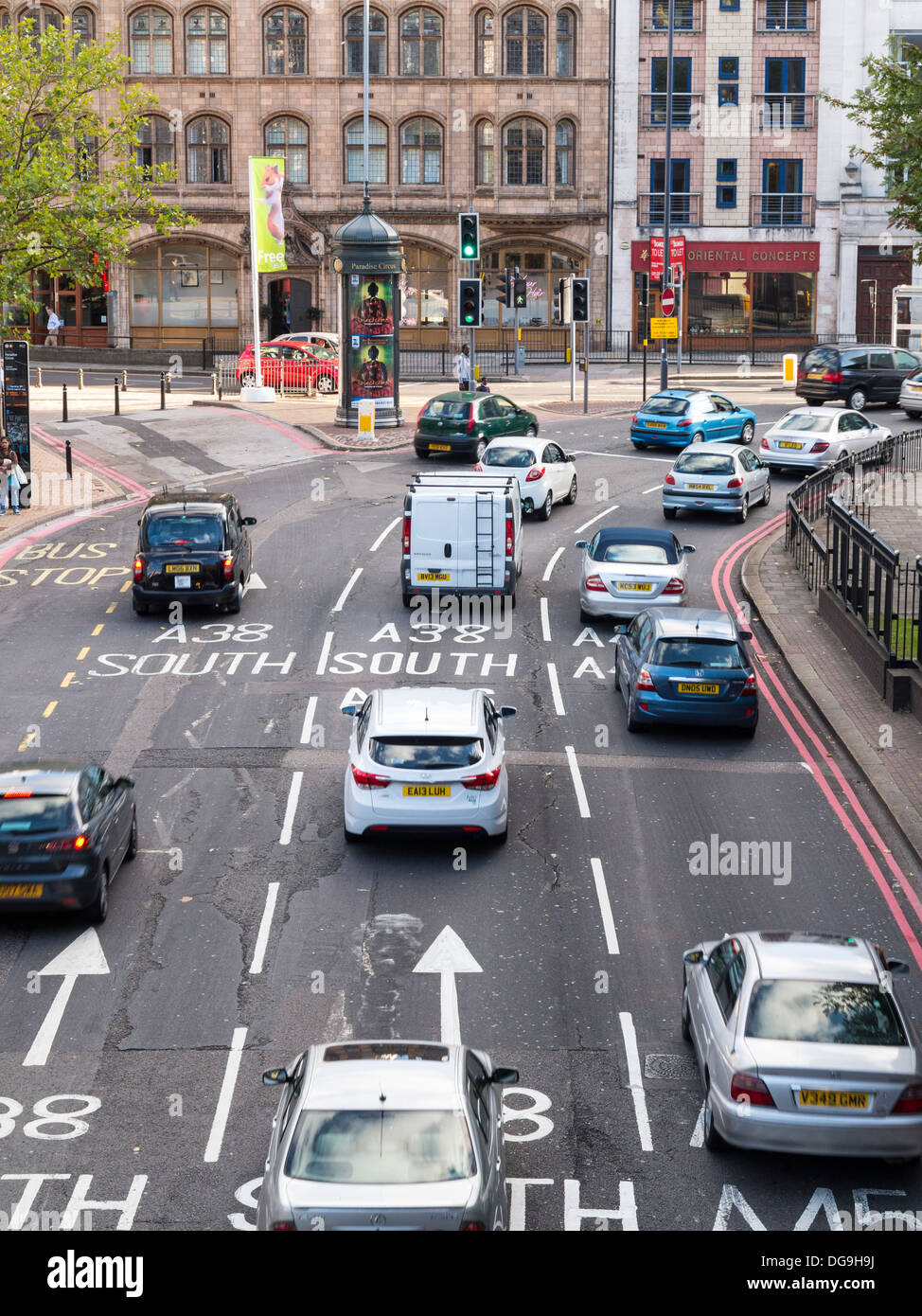 Road junction with three lanes and traffic in Birmingham, Midlands, UK - Stock Image