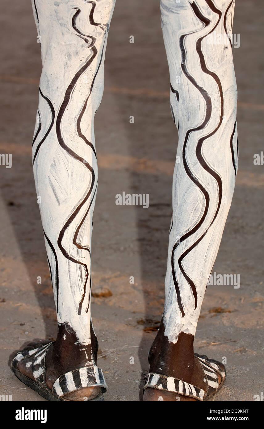 Painted legs, Nyangatom Bumi man, Omo river Valley, Ethiopia Stock Photo