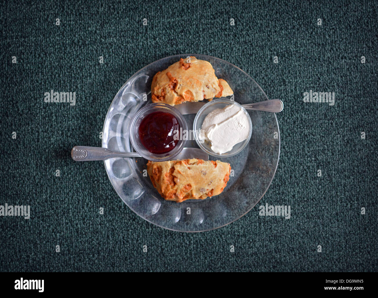 A butterscotch raisin scone with jam and clotted cream served at Robinson's tea room in Stony Brook, Long Island, Stock Photo