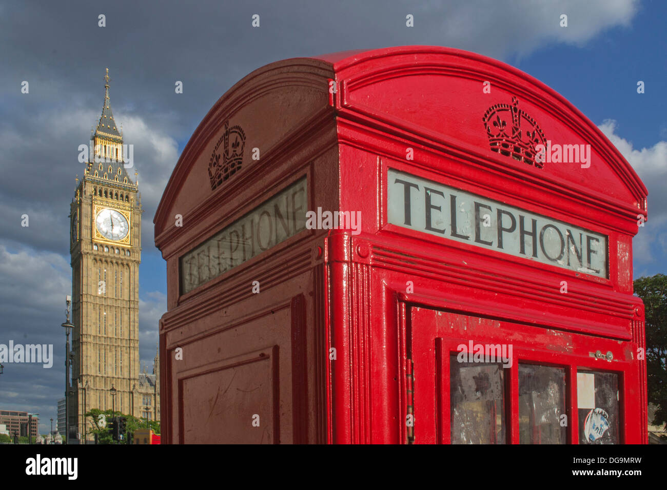 Traditional Red Telephone Box with Elizabeth Tower / Big Ben at the north end of the Palace of Westminster in the background, - Stock Image