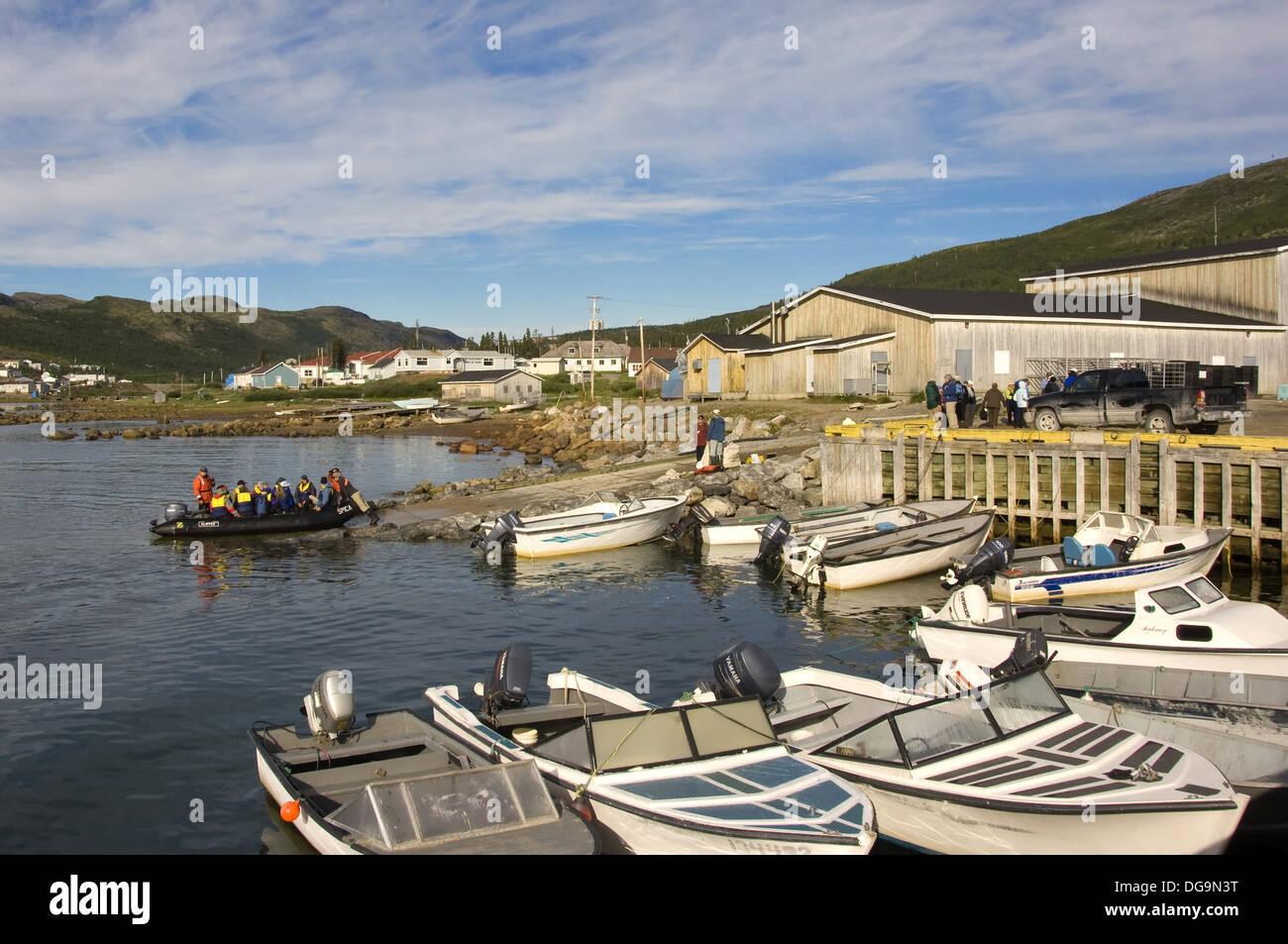 Zodiac with tourists accosting a wharf of Nain, Labrador