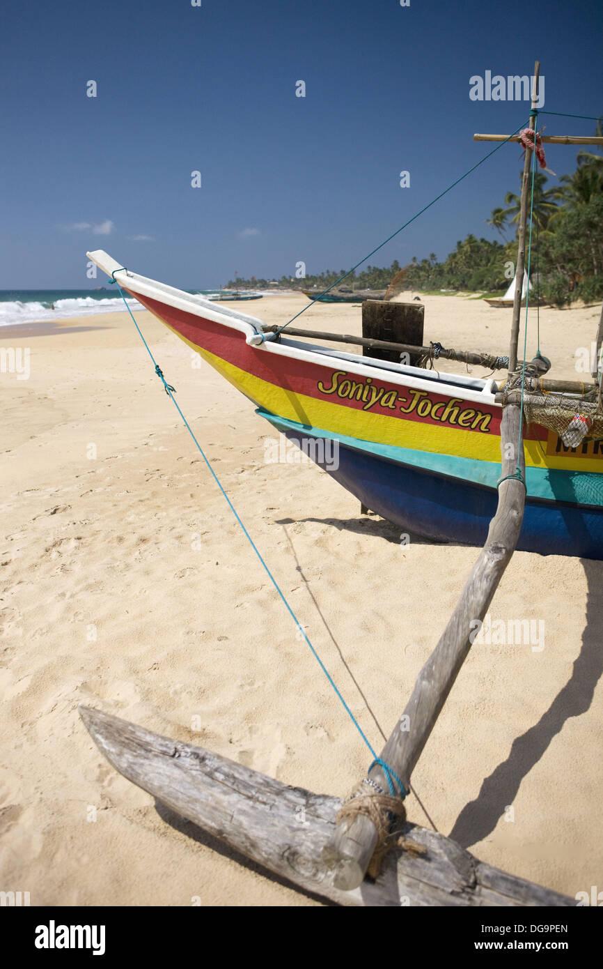 Outrigger on Hikkaduwa Beach, Sri Lanka Stock Photo