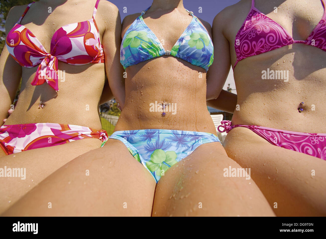 Close-up of Three women in Bikinis at poolside Stock Photo ...