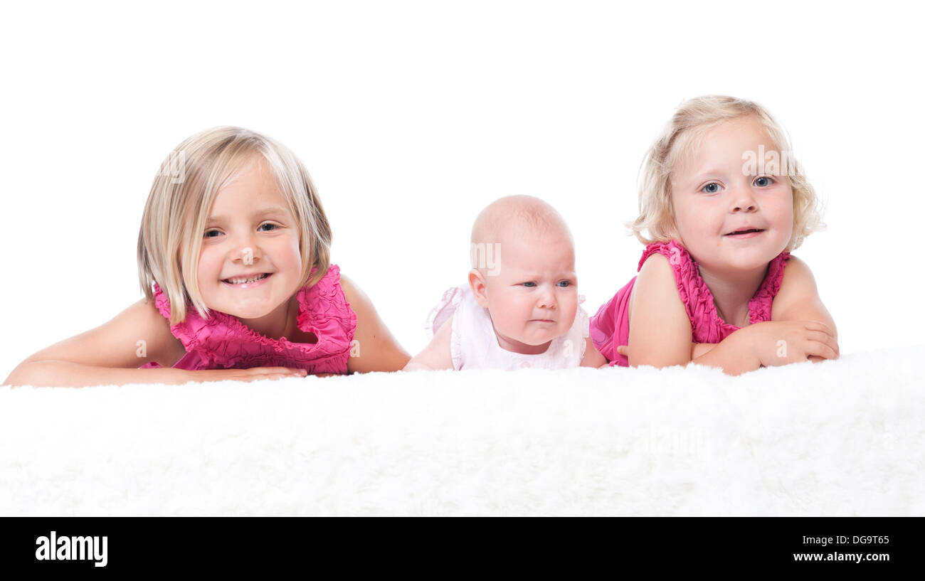 happy little girls with baby sister - Stock Image