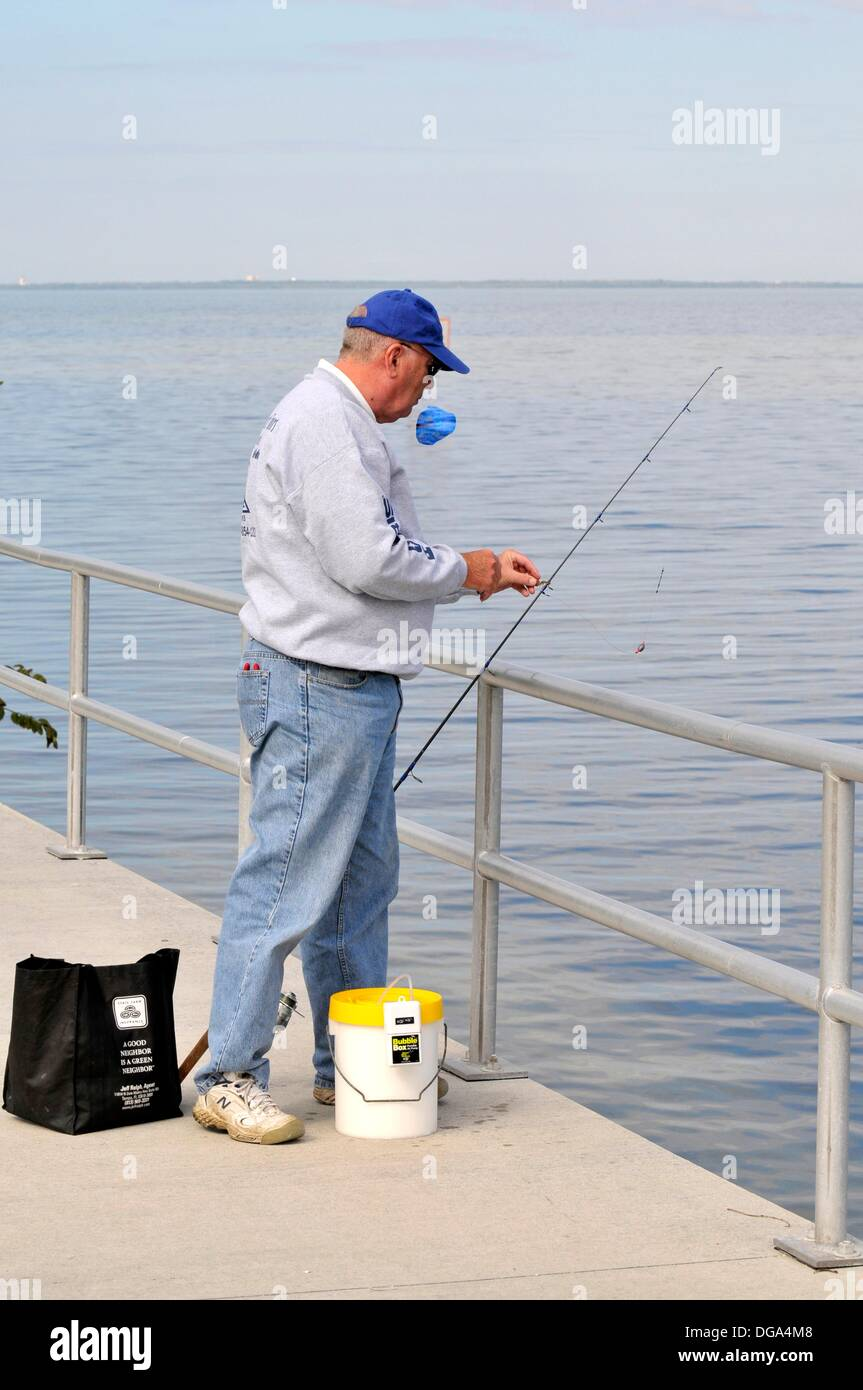 Fishing in Tampa Bay Florida at E G Simmons Park Rusking Florida - Stock Image