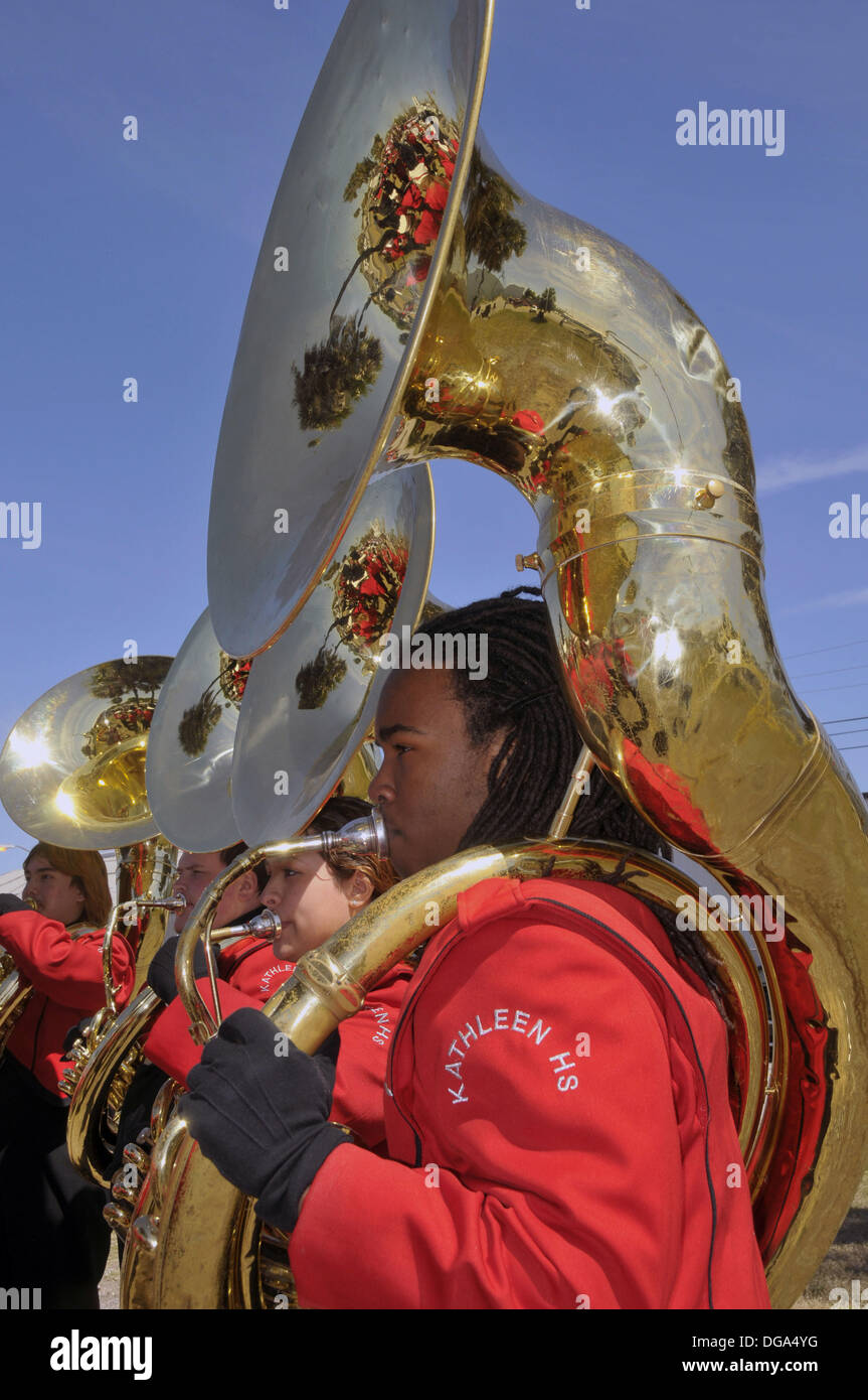 African American High School Band Member plays tuba at Strawberry Festival Parade Plant City Florida - Stock Image
