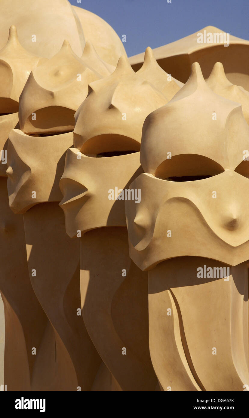 Detail of the fanciful chimney pots at the top of La Pedrera or Casa Mila in the city of Barcelona. Catalonia, Spain - Stock Image