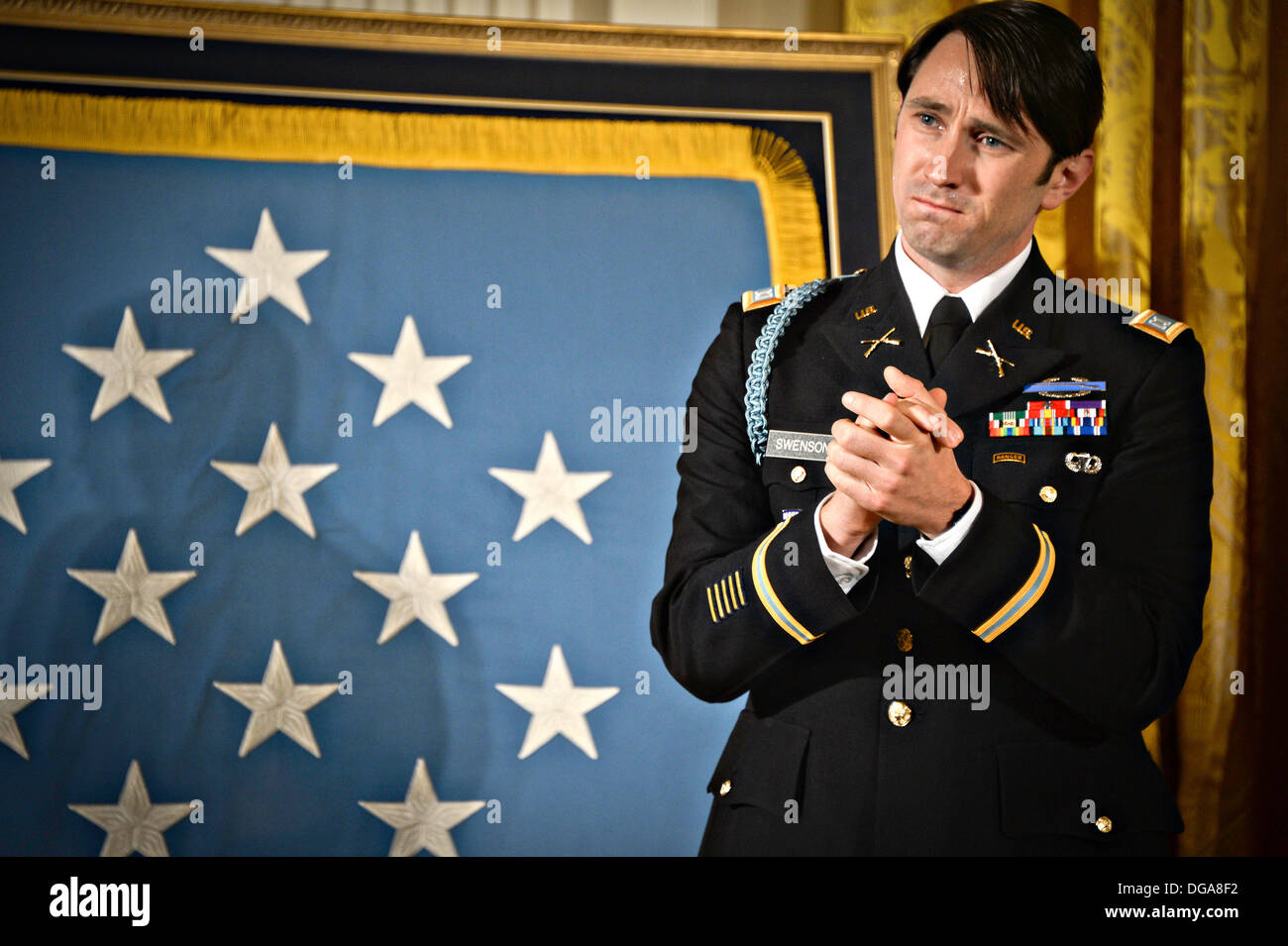US Army Capt. William D. Swenson during the Medal of Honor ceremony in the East Room of the White House October 15, 2013 in Washington, DC. The Medal of Honor is the nation's highest military honor. - Stock Image