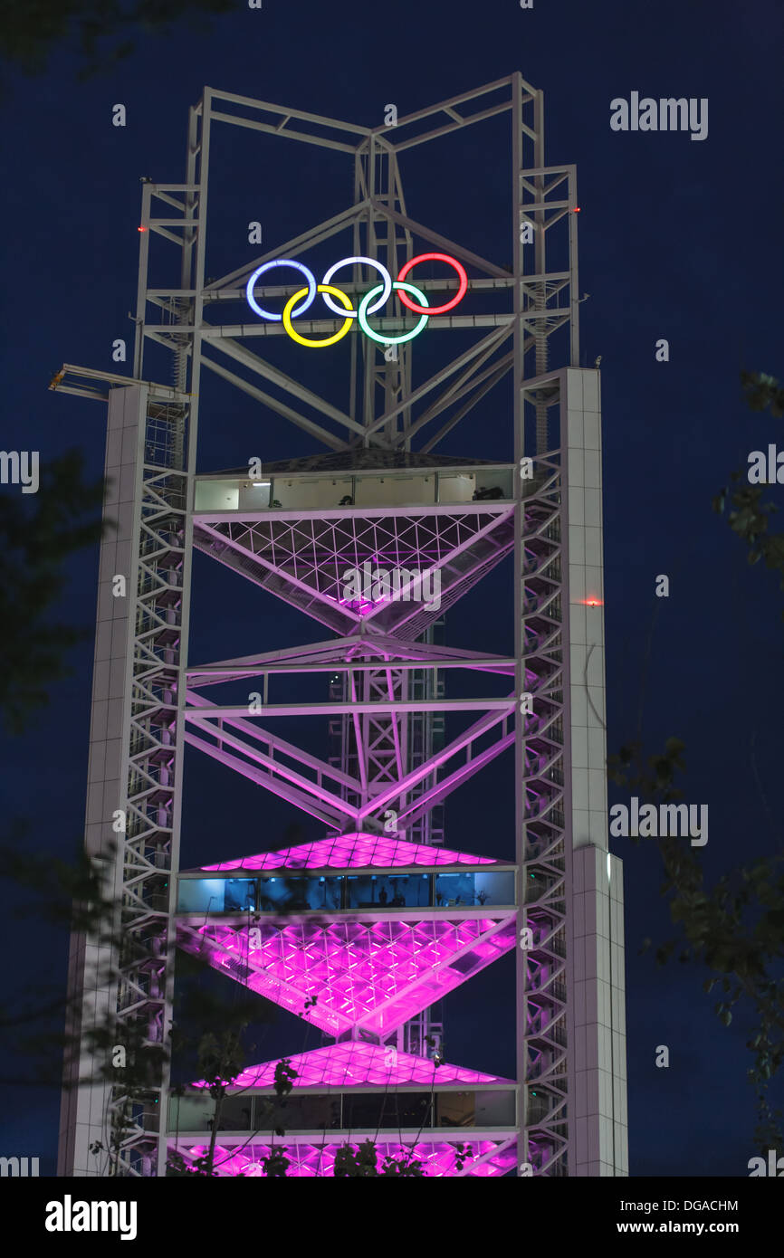 Olympic Tower glows pink with 5 Olympic rings lit up on top at night during the Summer Olympics games in 2008 in Beijing, China. - Stock Image
