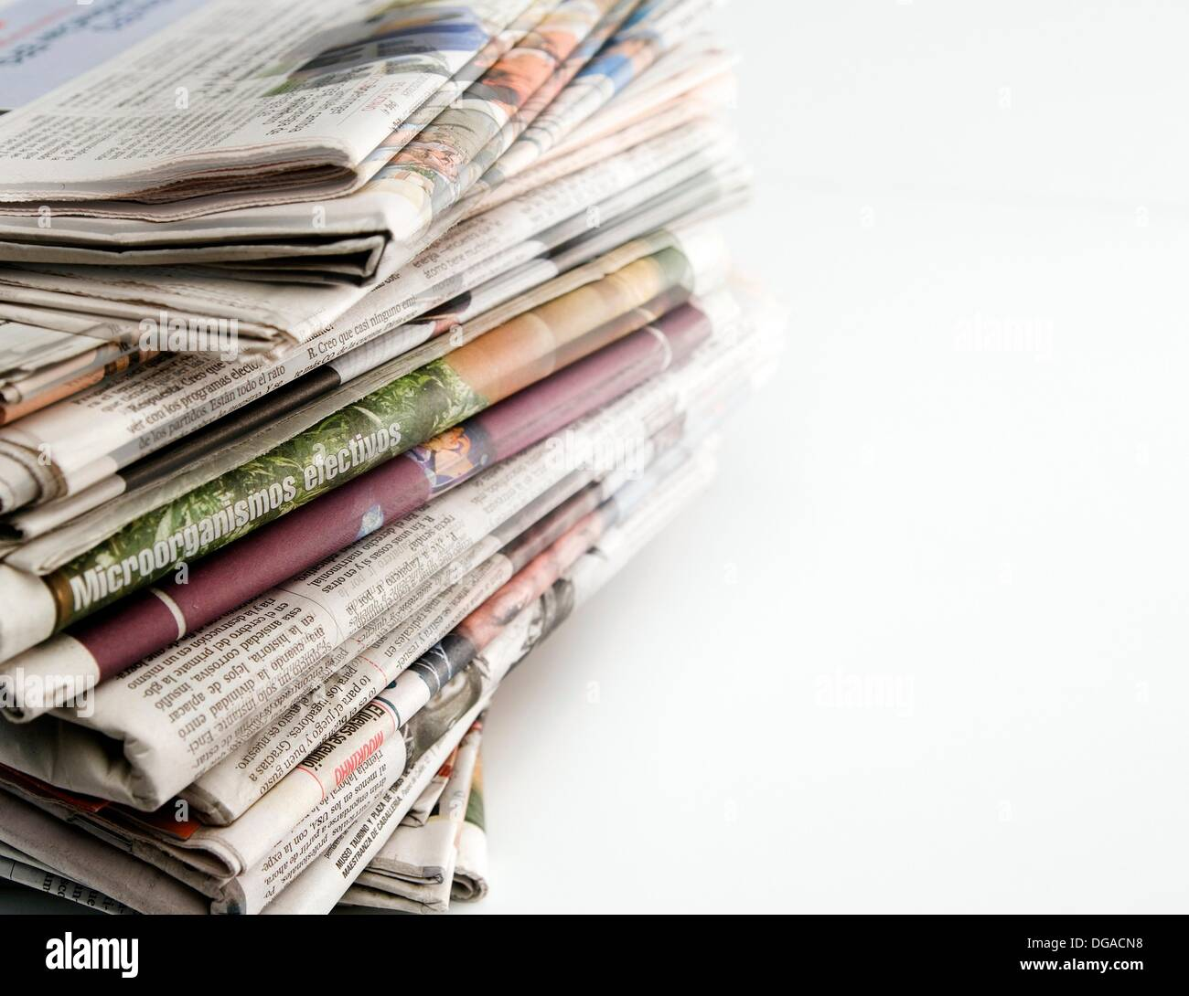 Pile Of Old Newspapers Stacked On A White Background