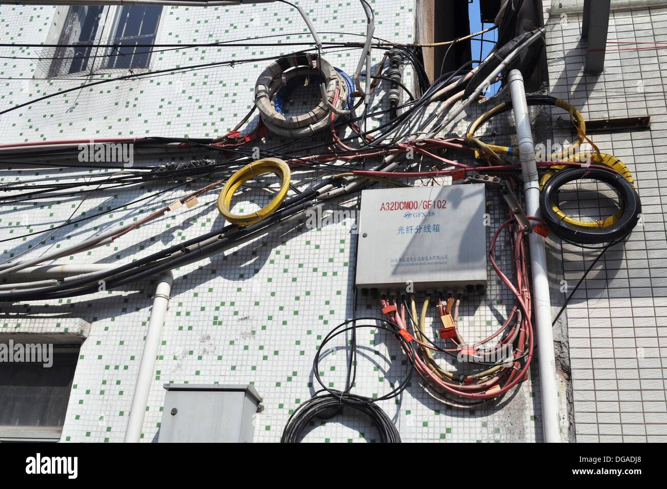 Dongguan (China): electrical wires mess on a house wall Stock Photo ...