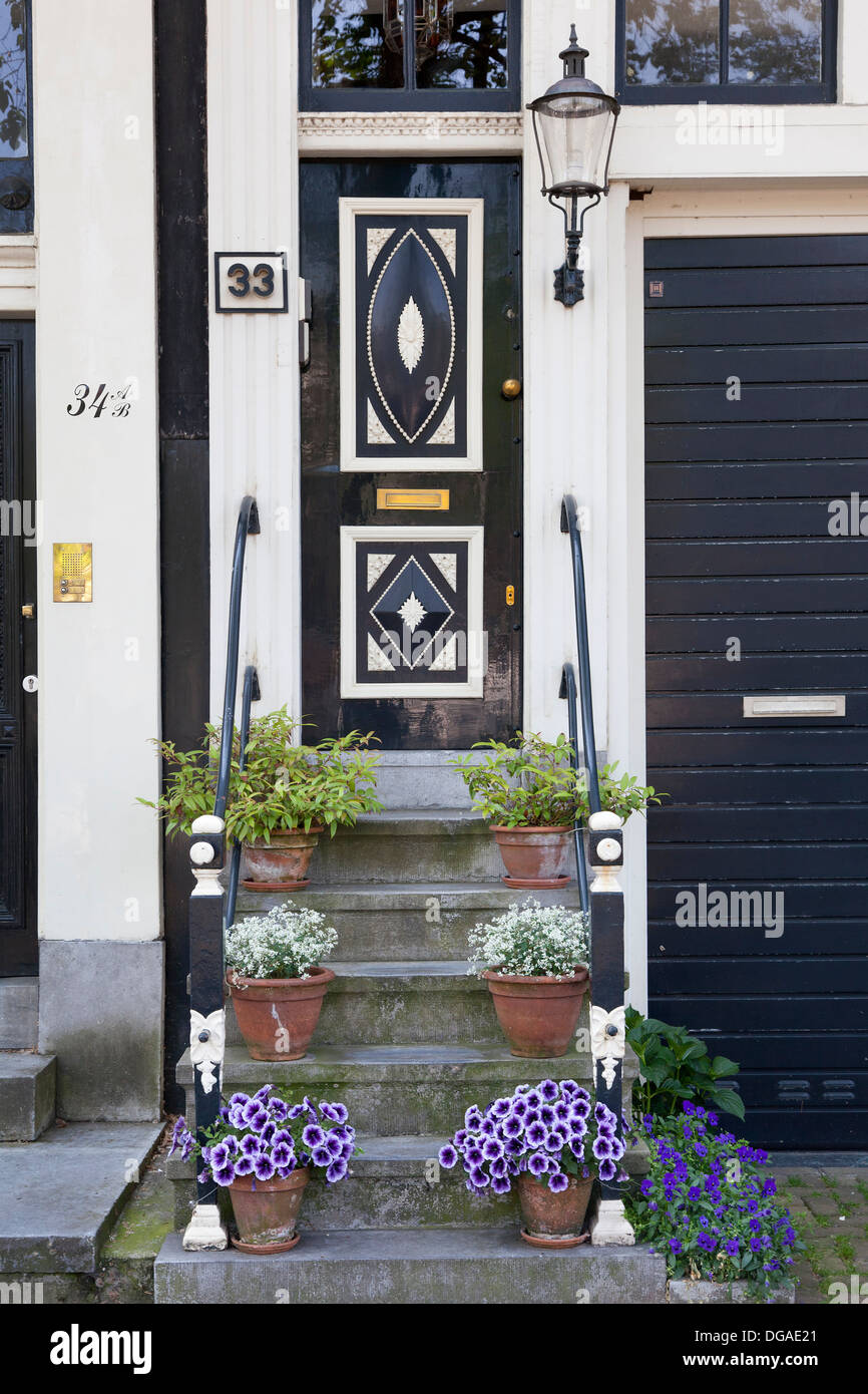 Staircase with flowers in Amsterdam in summer - Stock Image