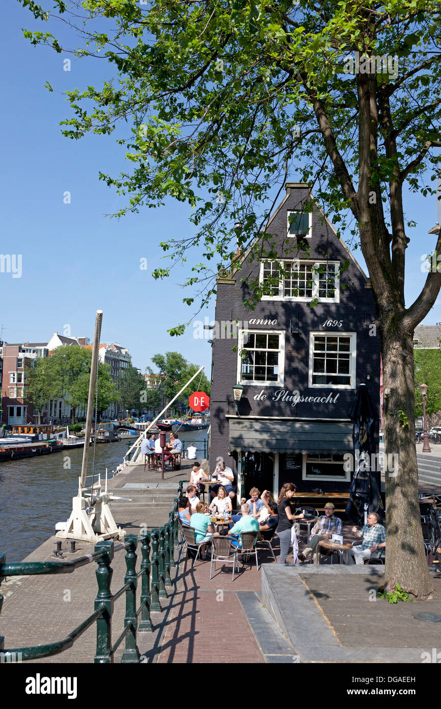 Terrace beside a lock in the canal in Amsterdam - Stock Image