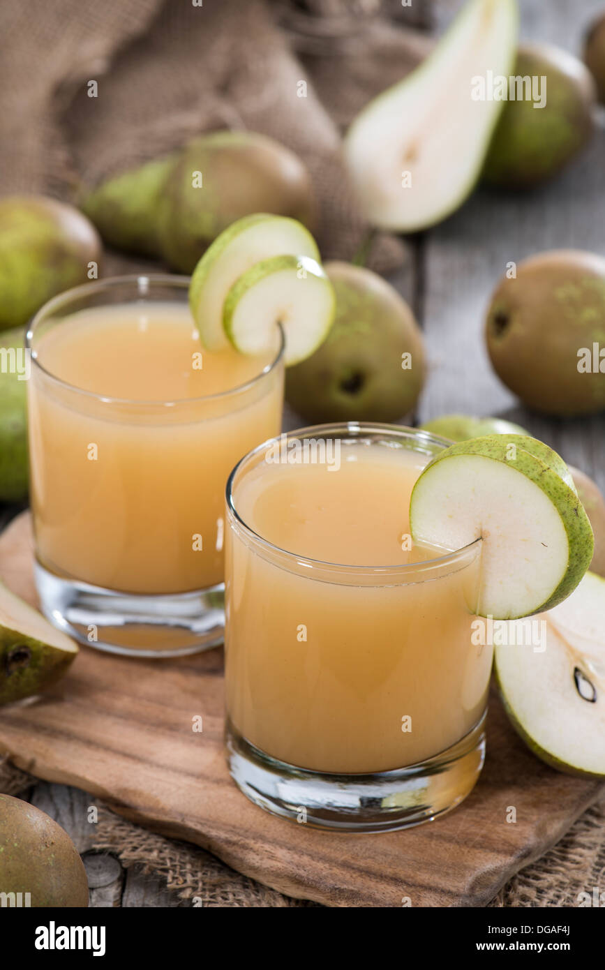 Fresh homemade Pear Juice with some fresh fruits - Stock Image