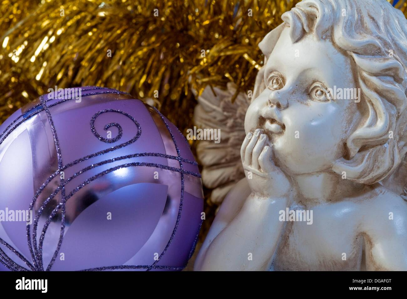 Angel and violett bauble as christmas decoration - Stock Image